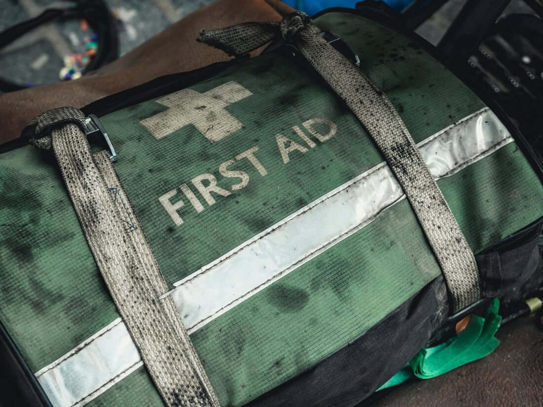 Prepper first aid kit tied down in a vehicle