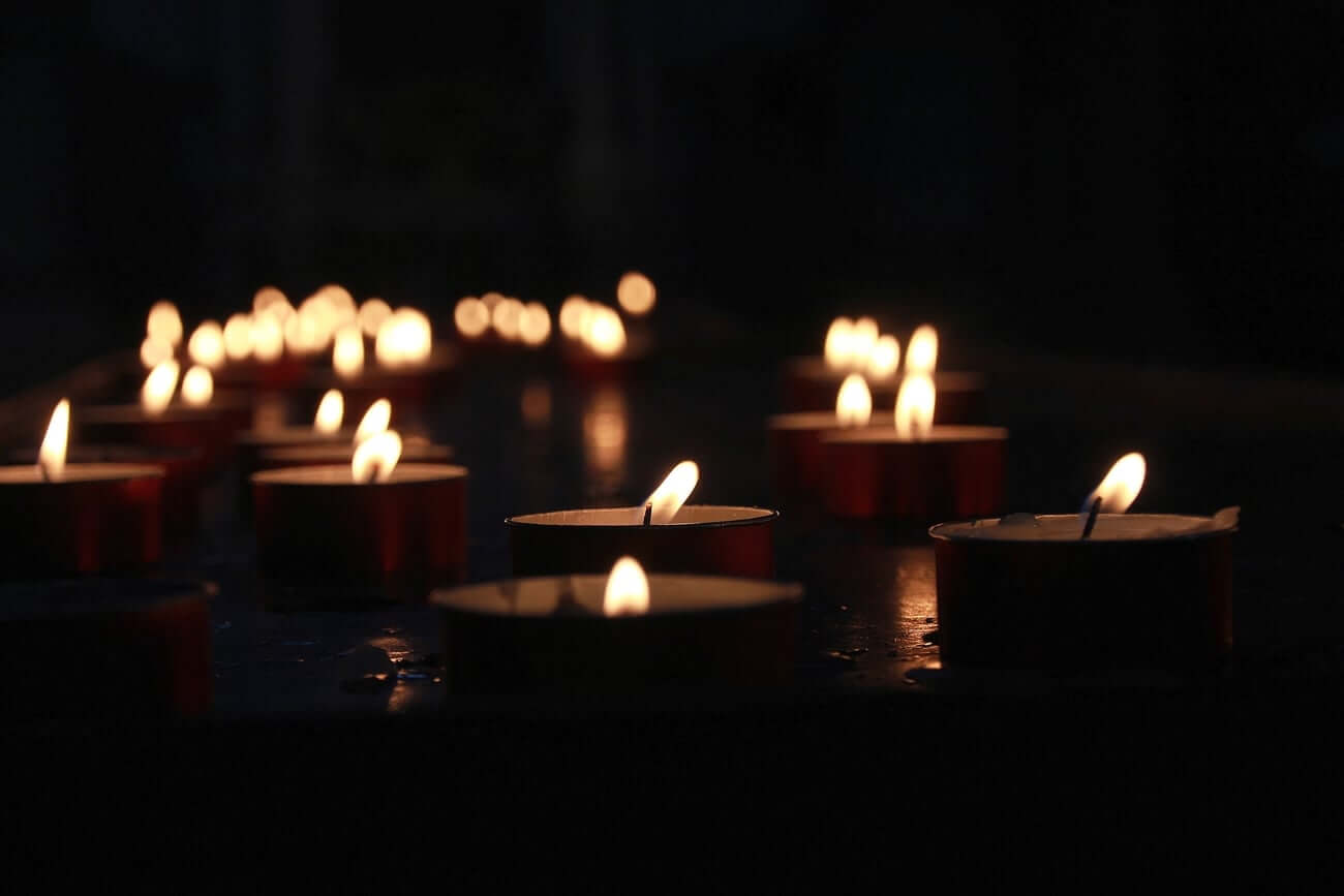 Some of the best emergency candles sitting on a table in the dark
