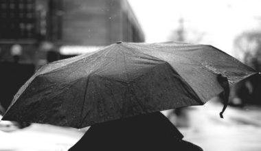 Man walking with a tactical umbrella